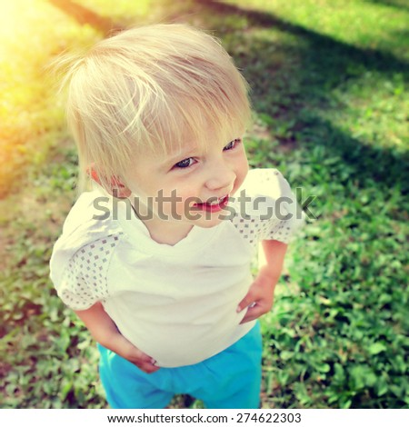 Toned Photo of Happy Child in the Summer Park - stock photo