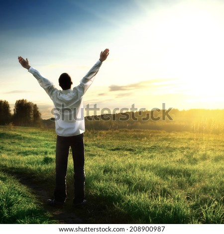 Toned photo of Happy Man silhouette on Sunset background - stock photo