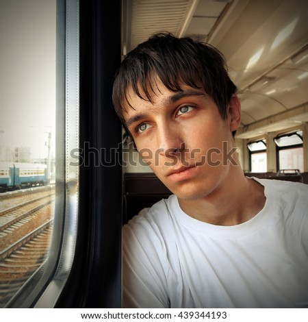 Toned Photo of Sad Teenager in the Train - stock photo