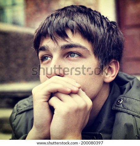 Toned photo of sad Teenager Portrait outdoor - stock photo
