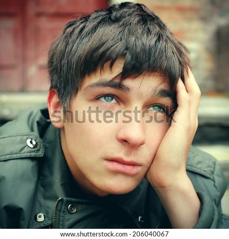 Toned photo of sad Teenager Portrait outdoor - stock photo