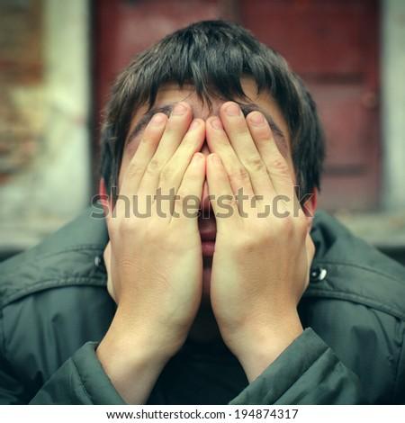 Toned photo of Sad Teenager with hidden Face closeup - stock photo