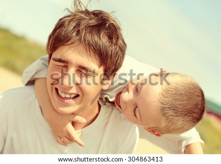Toned Photo of the Playful Brothers outdoor - stock photo