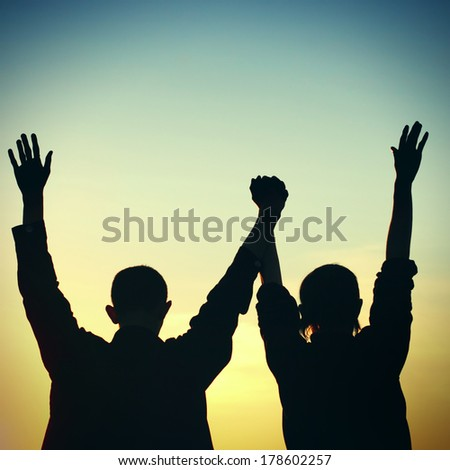 Toned photo of Two Friends silhouette on sunset background - stock photo