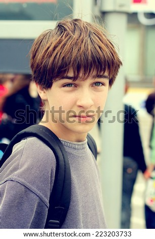 Toned Photo of Worried Teenager on the City Street - stock photo