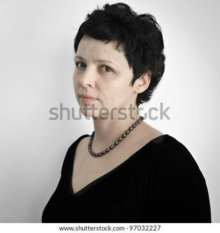 Toned Portrait of a middle aged woman against a gray background. - stock photo