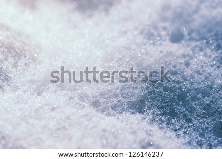 Toned pure foam close-up with shallow depth of field - stock photo