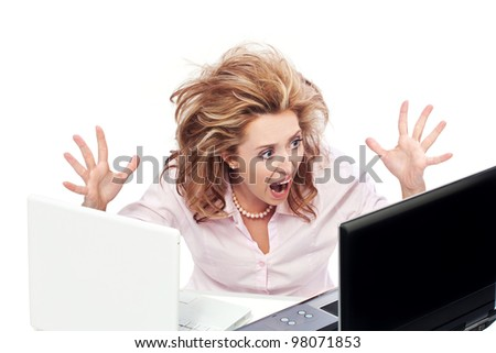 Too much work and stress / Businesswoman with two laptops screaming - stock photo