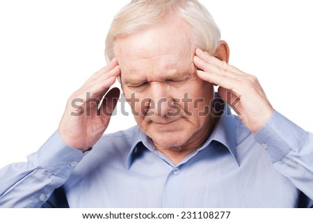 Too stressful day. Frustrated senior man in formalwear touching head with fingers and keeping eyes closed while standing against white background - stock photo