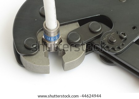 Tool for mounting TV connectors - stock photo