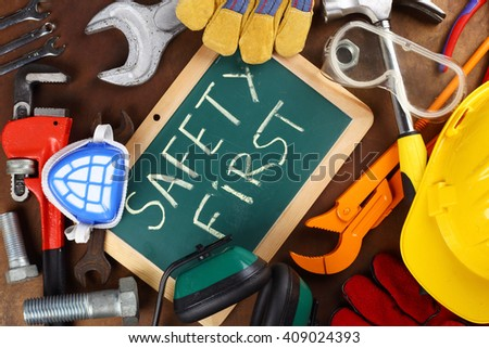 tools and board with the inscription SAFETY FIRST - stock photo