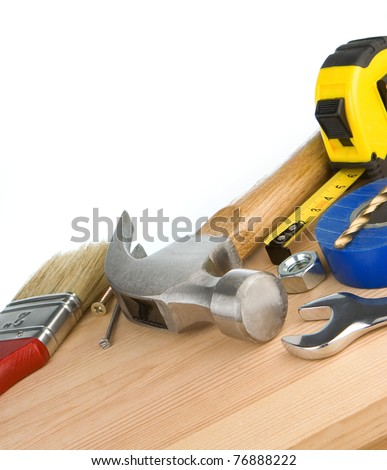tools and instruments on wooden brick isolated at white background - stock photo