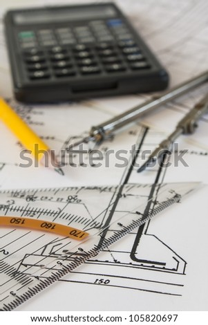 tools and mechanisms detail on the background of engineer drawings - stock photo