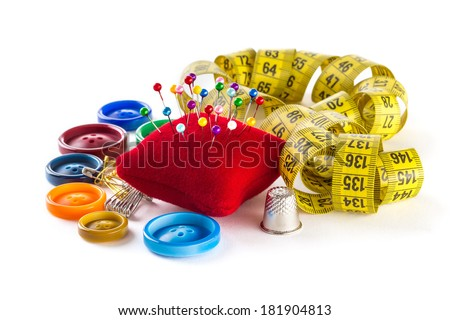 Tools for sewing and handmade: measurement, button, thimble, pins on white background - stock photo
