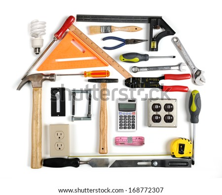 Tools forming a house with energy efficiency chimney - stock photo