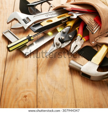 tools in tool belt on wood planks - stock photo