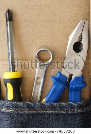 tools jeans with blank paper - stock photo