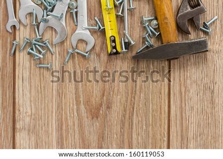 tools kit border on wooden  parquet planks - stock photo