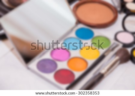 Tools make-up artists, blurred background - stock photo