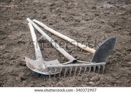 Tools of the garden, shovel, hoe, rake - stock photo