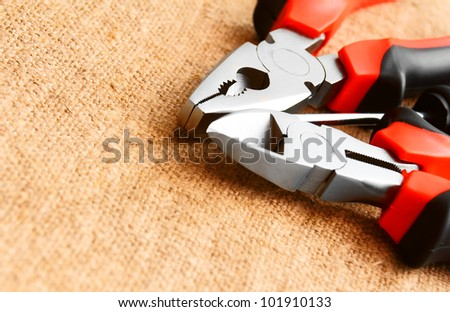Tools on a fabric. - stock photo