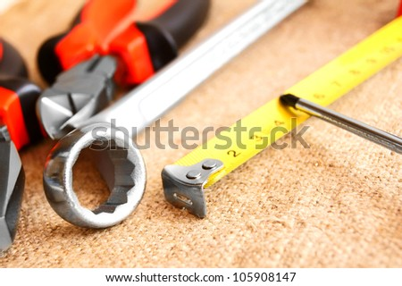 Tools on a fabric . - stock photo