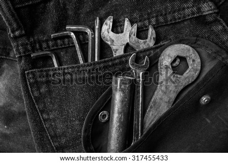 Tools on a workers pocket, Black and white photo - stock photo