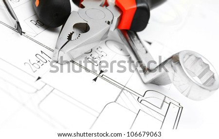 Tools on the drawing . - stock photo