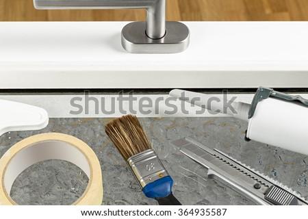 tools on white windowe frame - stock photo