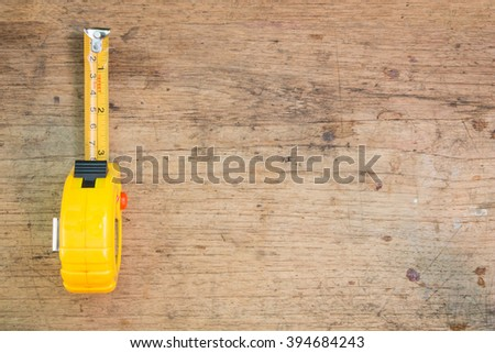 tools supplies on a wooden background,tape measure selective focus - stock photo