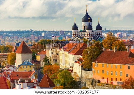 Toompea hill with fortress wall, tower and Russian Orthodox Alexander Nevsky Cathedral, view from the tower of St. Olaf church, Tallinn, Estonia - stock photo