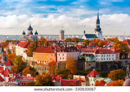 Toompea hill with tower Pikk Hermann, Cathedral Church of Saint Mary Toomkirik and Russian Orthodox Alexander Nevsky Cathedral, view from the tower of St. Olaf church, Tallinn, Estonia - stock photo