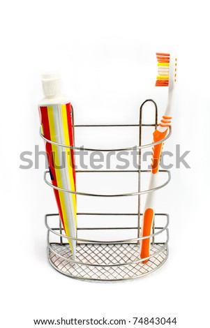 Tooth brush beside toothpaste isolated on white - stock photo