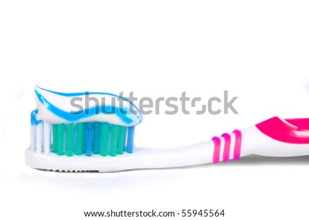 Tooth Paste on the pink Dental Brush isolated with white background - stock photo