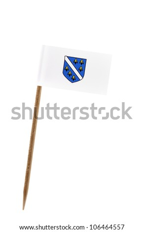 Tooth pick wit a small paper flag of Bosnia Herzegovina - stock photo