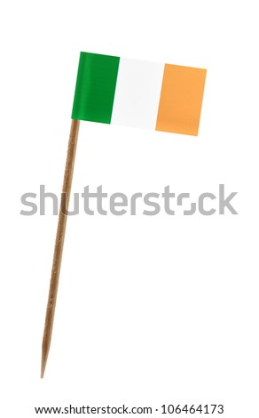 Tooth pick wit a small paper flag of Ireland - stock photo