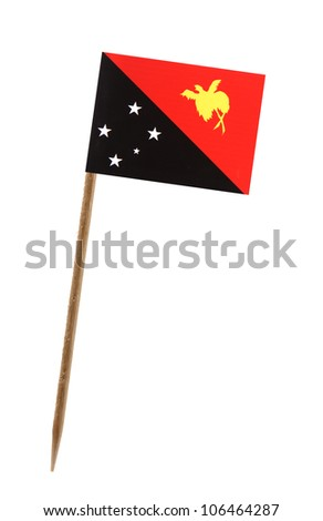 Tooth pick wit a small paper flag of Papua New Guinea - stock photo