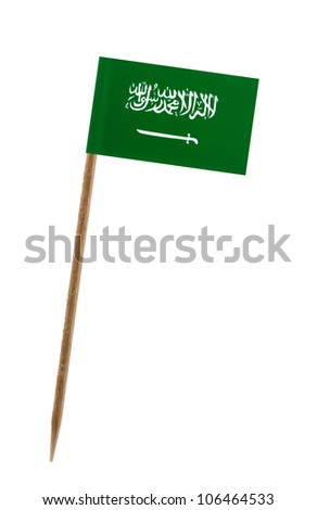 Tooth pick wit a small paper flag of Saudi Arabia - stock photo