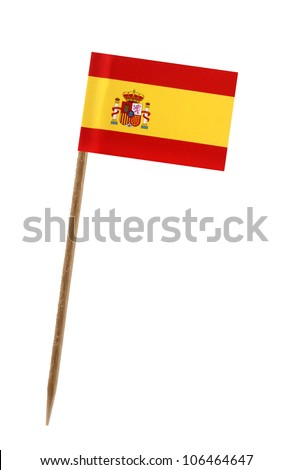 Tooth pick wit a small paper flag of Spain - stock photo