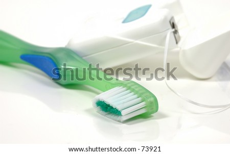 Toothbrush and Floss - stock photo
