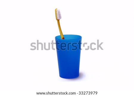 Toothbrush in a color holder - stock photo