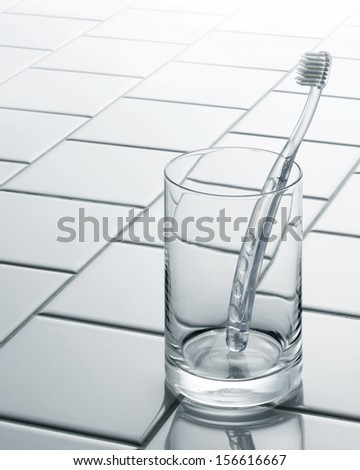 toothbrush in glass - stock photo