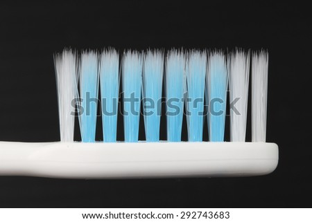 Toothbrush isolate on black background - stock photo