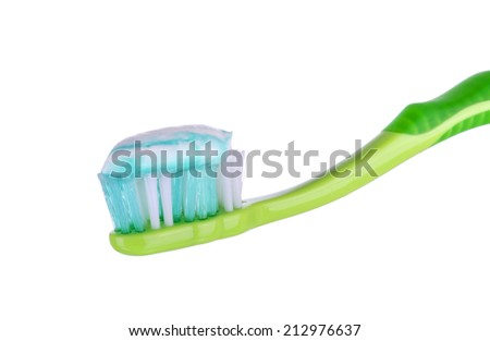 Toothbrush with toothpaste isolated on white - stock photo