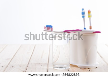 Toothbrush With Toothpaste on glass - stock photo