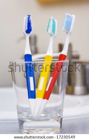 Toothbrushes in Glass - stock photo