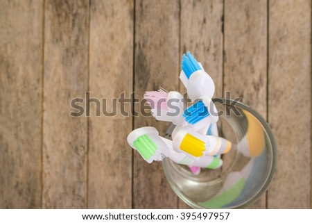 toothbrushes on wood plank background, soft focused, top view - stock photo