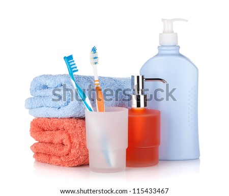 Toothbrushes, shampoo bottles and two towels. Isolated on white background - stock photo