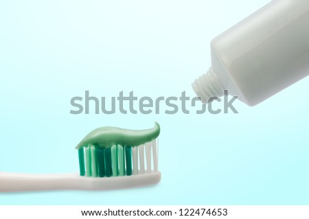 Toothbrushes white and color - stock photo