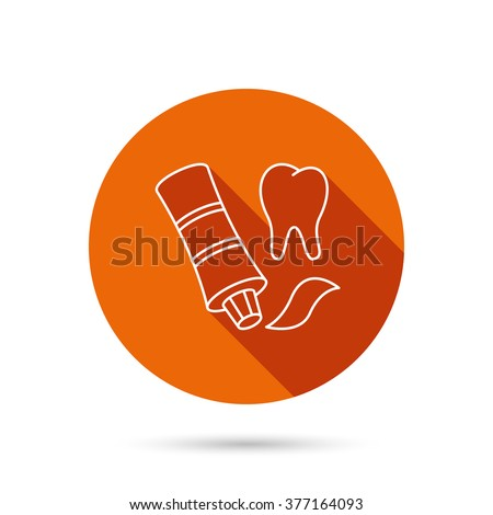 Toothpaste icon. Teeth health care sign. Round orange web button with shadow. - stock photo